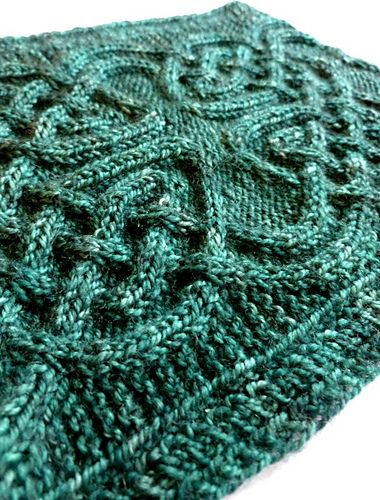 Celtic Cabled Cowl from the new issue of Knitty. Knit in 4 ply, but taking less than 300 yards.