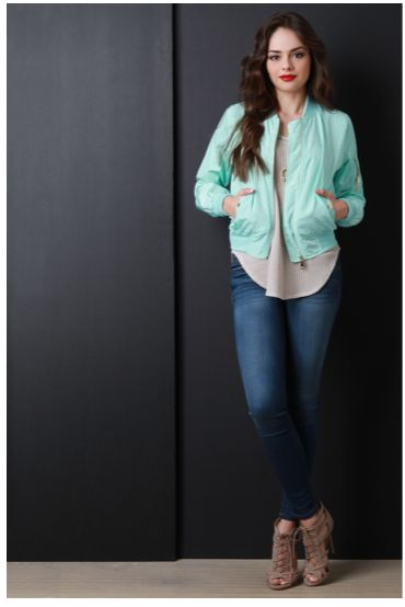 A lightweight bomber-style jacket featuring swishy wind-resistant fabric, elastic rib knit trim, and a zipper front. Jacket also features smooth interior lining and two side pockets with glossy snap b