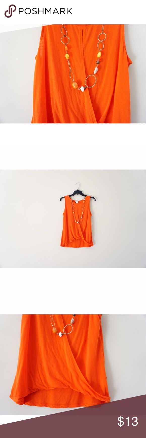 H&M (Conscious Collection) Tank Pumpkin orange and perfect for fall 🎃🍂 High-low cut (shorter in the front, longer in the back) with multiple open slits down the front! Looks best paired with mid-waisted or high-waisted bottoms. Necklace in photo comes with purchase of shirt. If you have any questions please let me know! 😉 H&M Tops Tank Tops