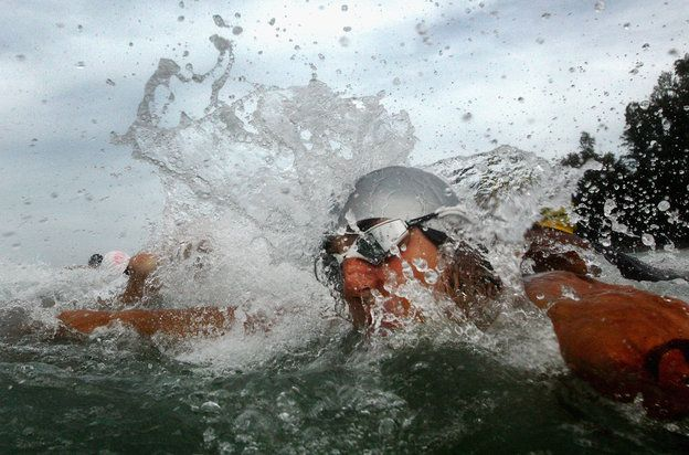 Quinn Rooney - Getty Images PHUKET, THAILAND - NOVEMBER 17: Competitors dive into the water for the start of the Men's triathlon during the 2014 Asian Beach Games at Nai Yang Beach on November 17, 2014 in Phuket, Thailand. (Photo by Quinn Rooney/Getty Images)