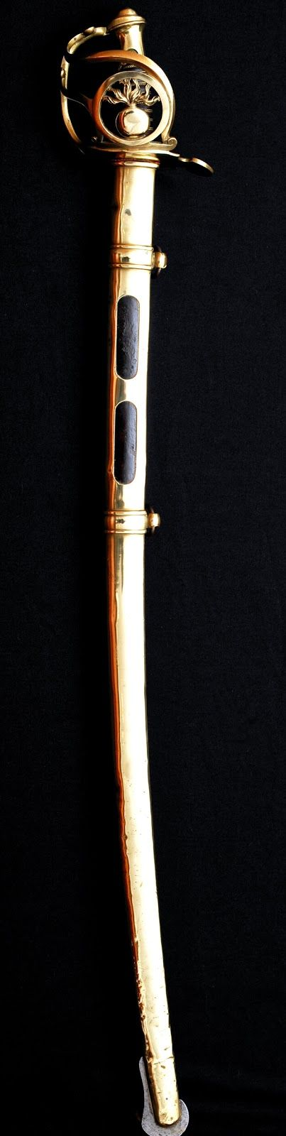 One the most beautiful and famous sword from the Napoleonic period. The Grenadier à cheval de la Garde Impériale sword third pattern. This saber is full of emotion and glory, the blade has heavy signs of wear from combat. The copper scabbard has spurs wears from the Spanish war, the Russian campaign or Waterloo . Dated from June 1811, month of the baptism of the king of Rome, Napoleon's son and retreat from Portugal by Wellington. The best sword I ever owned...