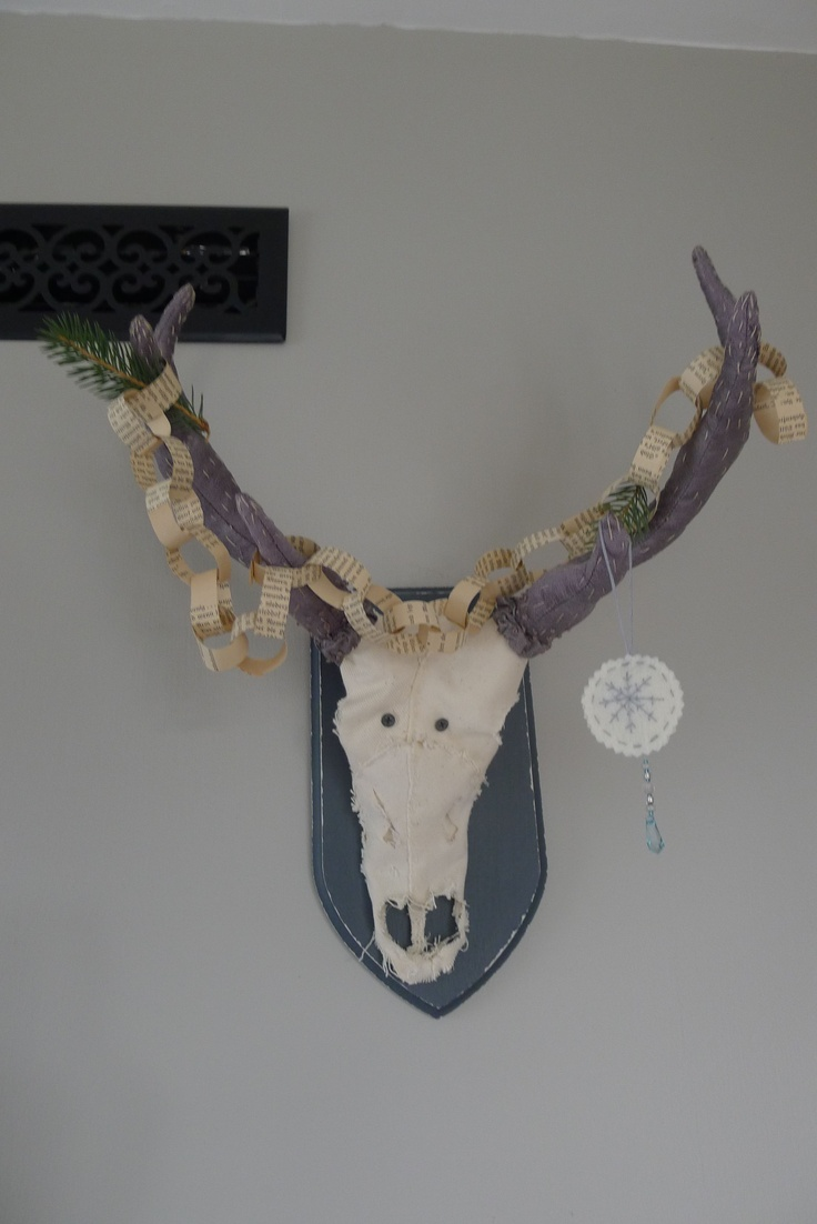 Merry  Eco Christmas! Old newspaper garland on fake antlers made from repurposed silk.
