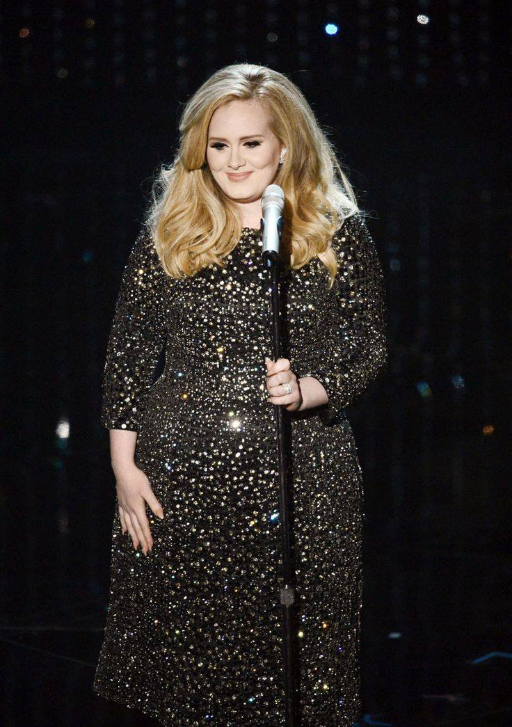 """Adele performing her """"Skyfall song at the ceremony in @Van Cleef & Arpels 1970 """"Feuilles"""" earrings featuring diamonds set in platinum, from the Van Cleef & Arpels Collection, and Van Cleef & Arpels """"Snowflake"""" diamond band ring set in platinum from the Snowflake Collection."""
