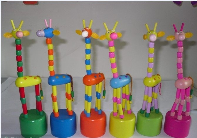Push Bottom Toys - Sheree, Taija and I loved to play with these - you push the bottoms and they moved. We'd try to only make the head move or only make it sit down.  They had different animals but I think the giraffe was most popular
