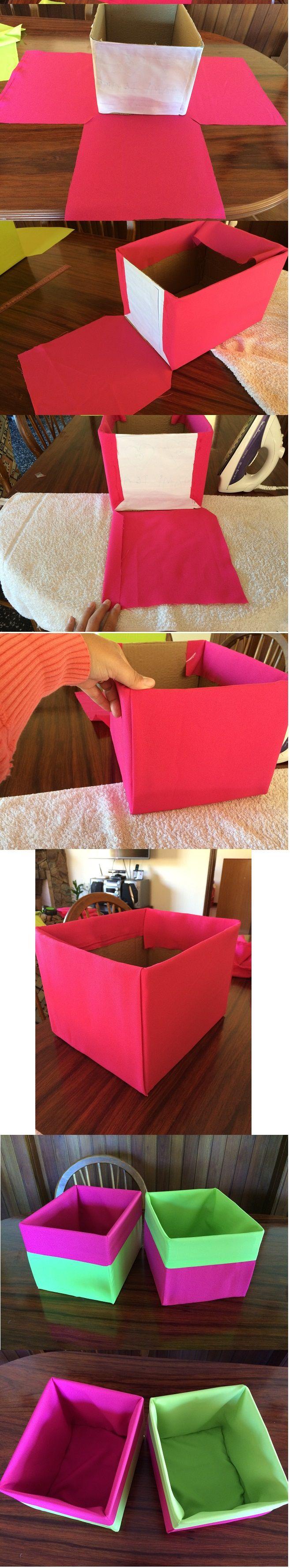 Cajas de cartón forradas con tela.