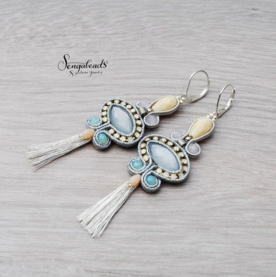 Hand embroidred soutache earrings in silver gray and a smack of light blue…