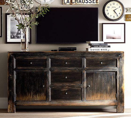 Cool idea of having a rustic buffet type piece as your TV stand/media console. Still hides everything and keeps them out of reach of small destructive hands. // Dawson Media Console | Pottery Barn