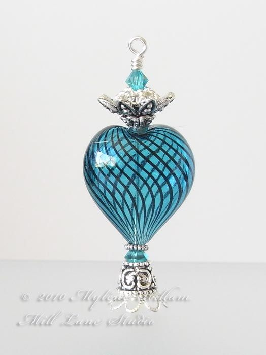Elegant aqua blue heart shaped perfume bottle is beautiful and unique. I can jus…
