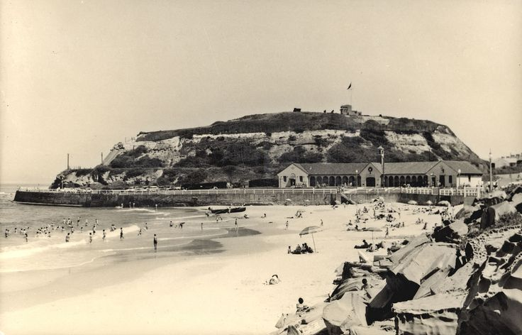 Nobby's Beach showing the Surf Club Pavilion. Fort Scratchley, the army coast artillery fort, is in the background. Vinco series no. 45.  This image was scanned from a photograph in the Newcastle and Hunter District Historical Society archives which are held by Cultural Collections at the University of Newcastle, Australia.  If you have any information about this photograph, please contact us.  Please contact us if you are the subject of the image, or know the subject of the image, and have…