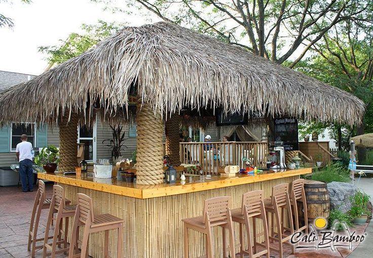 Diy tiki bar made with cali bamboo fencing and palm for Homemade tiki bar pics