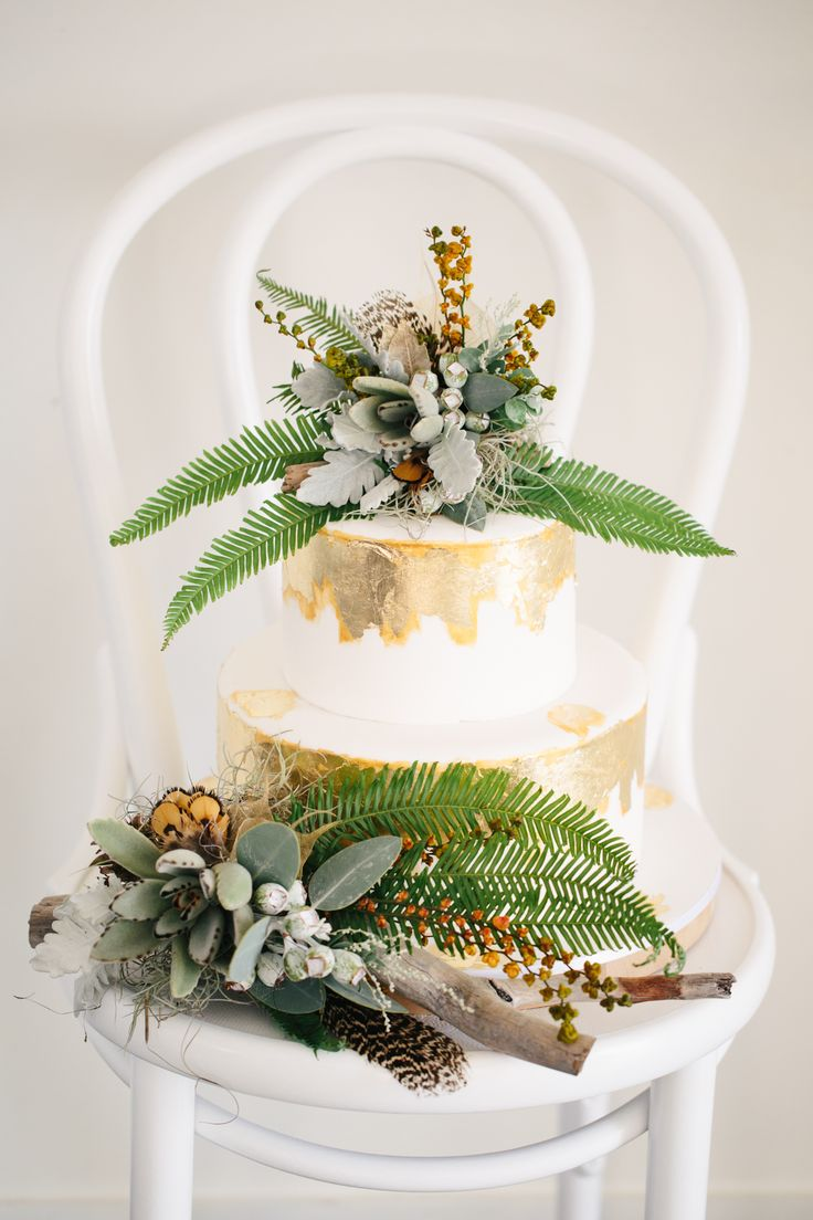 gold foil wedding cake with fern and native flower cake topper