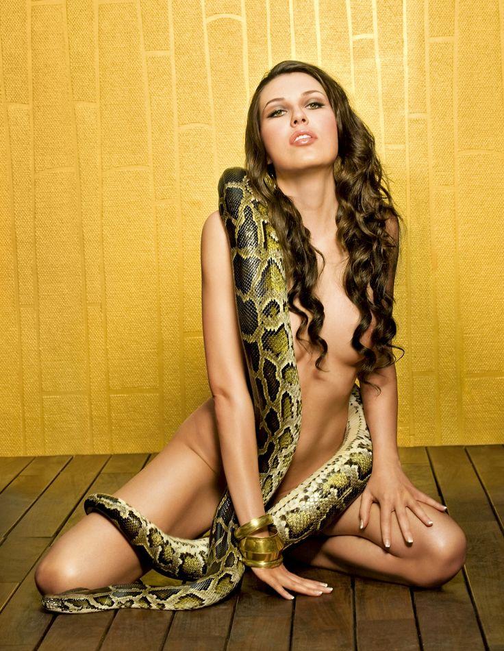 Woman masturbates with snake