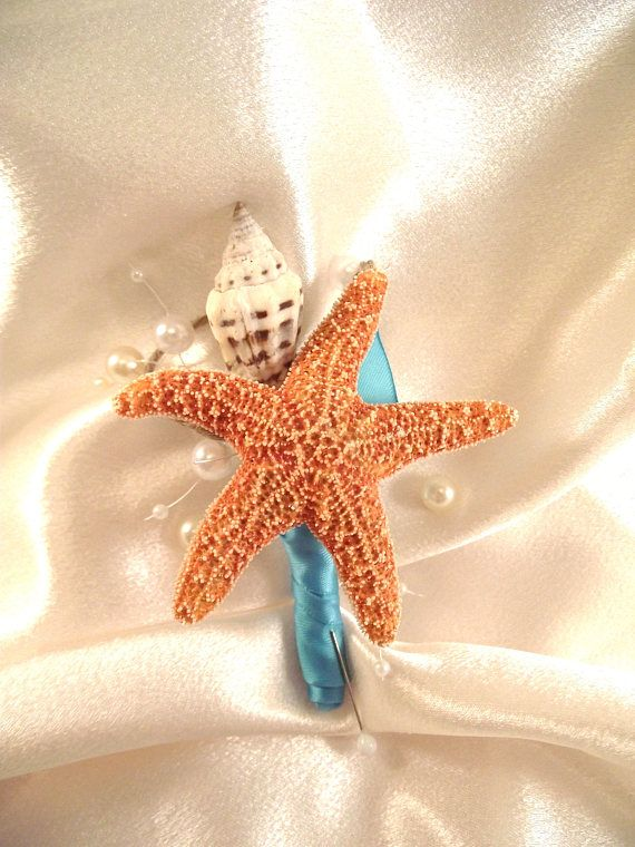 Perfect for prom or a beach wedding or event for the Groom, groomsmen or father of the bride or groom is this boutonniere that I designed with a sugar starfish with a conch shell, and ivory pearls. I covered the stem in a deep aqua blue ribbon (close to Davids Bridal Pool Blue)