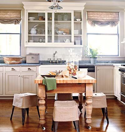 A Kitchen Island Surrounded With Four Small Stools Covered In Burlap Slipcovers Cottage