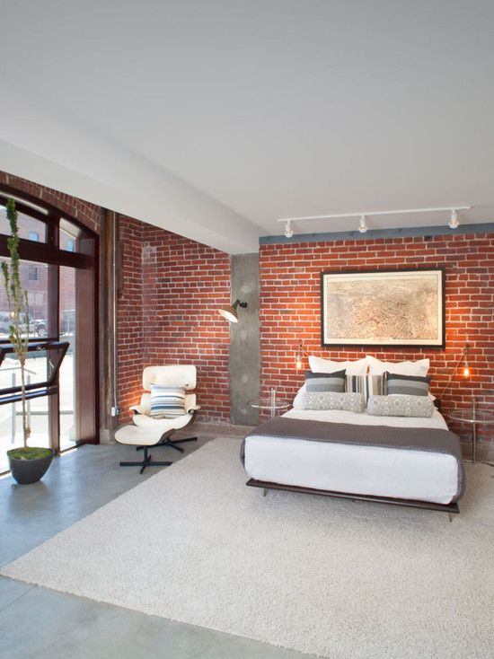 Beautiful red brick exposed wall combined with a cement screed floor