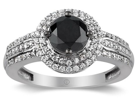 Brilliant cut black diamond and white gold dress ring with two halos and triple row shoulders of white diamonds weighing apx total 2.00 carats, perfect for some rock chick romance.   Available #fromthomas in store or online www.thomasjewellers.com.au #thomasjewellers #ilovethomas