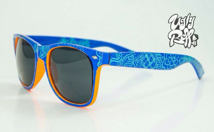 """Palm Tree Pattern"" Hand Painted Sunglasses in blue and orange contrasting colours. Custom painted by hand with great attention to detail using high quality paints and extra strong waterproof varnish."