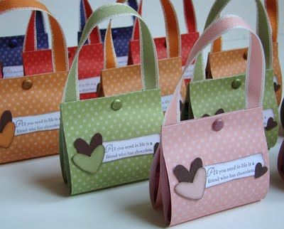 scrapbook paper.  hold 2 Giardelli pieces of chocolate.  cute favor
