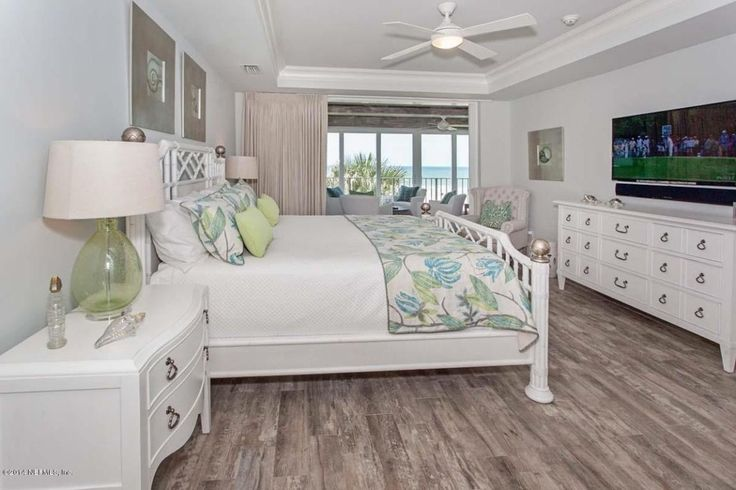 Tropical Master Bedroom with Marazzi montagna rustic bay 6 in. x 24 in. glazed porcelain floor and wall tile, Ceiling fan