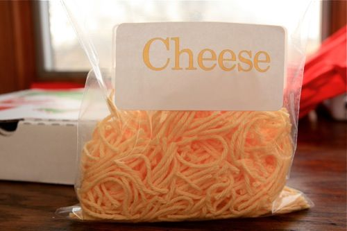 Cheese colored yarn cut to make shredded cheese for Pizza dramatic play.