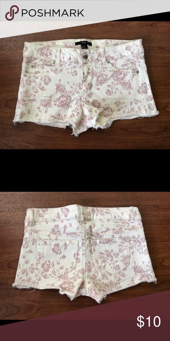 XXI Forever 21 juniors shorts size 26 XXI Forever 21 juniors shorts size 26. 98% cotton 2% spandex. Cream with light pink flowers. Some fading otherwise great condition with no holes or stains. Forever 21 Shorts