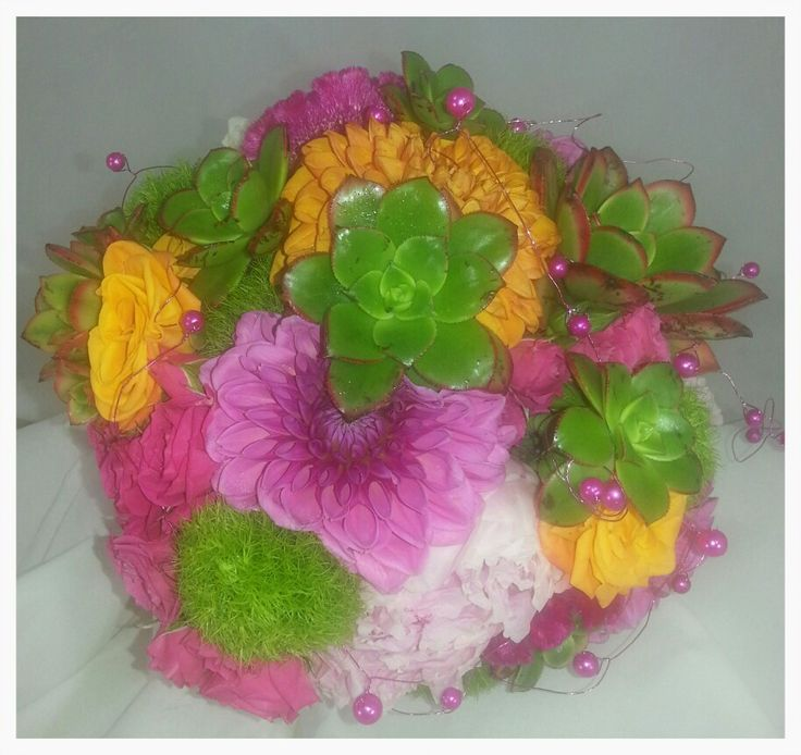 Fun And A Touch Of Fantasy Describe This Bright And Perky Bouquet. LOG  Cabin Florist