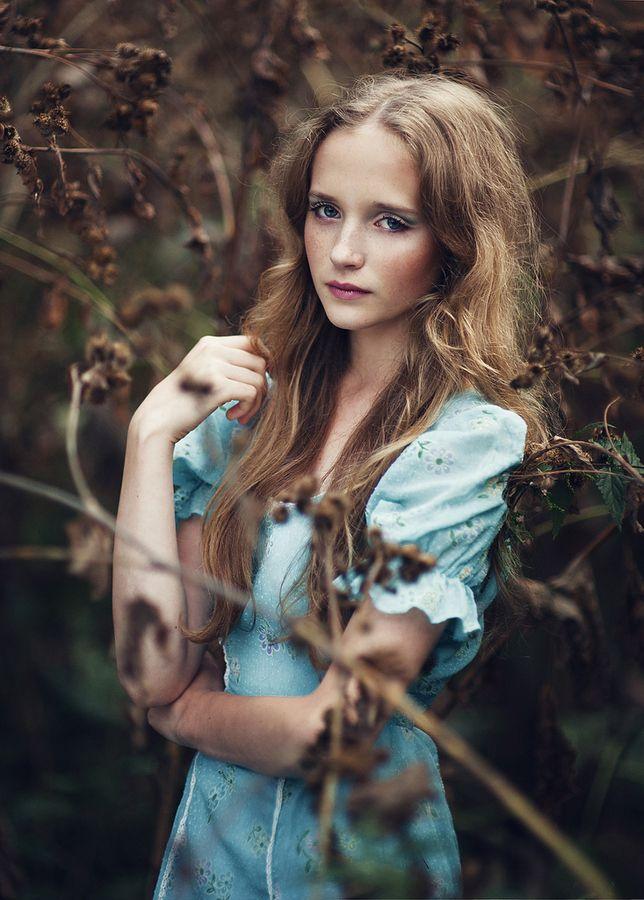 Friend. blue dress. long haired girl. dead leaves. forest. alice in wonderland.