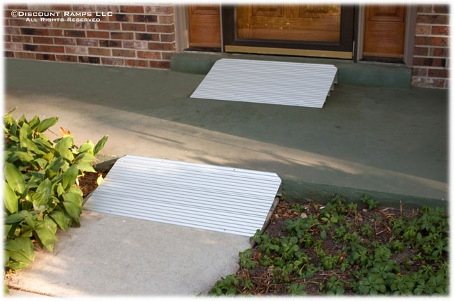 "Modular Threshold Ramp from Discount Ramps provides access across doorways and steps for people using wheelchairs, walkers, scooters or canes. Available in lengths from 4-7/8"" to 29-7/8""."