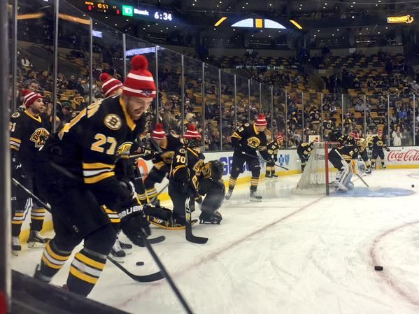 With the Super Bowl tomorrow the Bruins are wearing their Patriots 'Do Your Job' hats during warmups before their game tonight