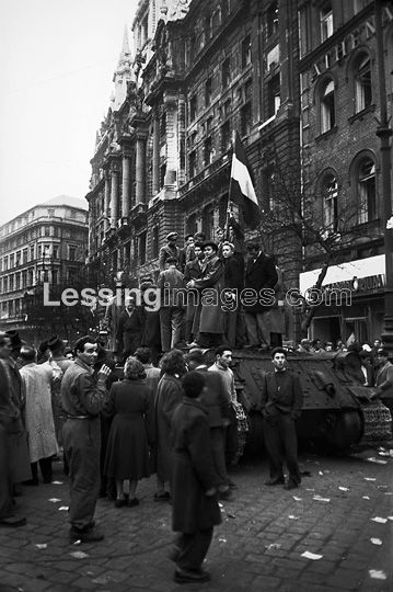 Insurgents have hoisted a Hungarian flag on a captured Soviet tank in front of the New York Palace on Lenin Ring (today again Erzebet körut) near Blaha Lujza Square.