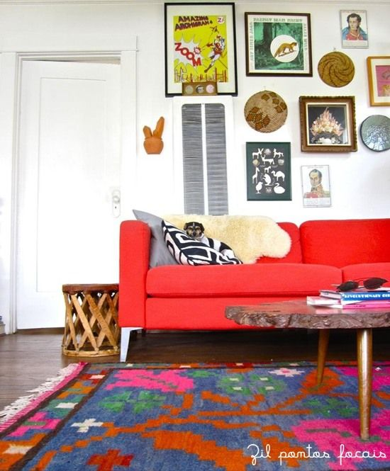 bright red couch and lots of colorful art