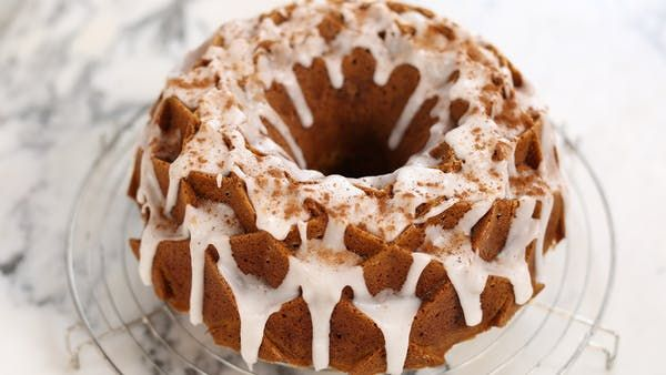 Recipe with video instructions: Ever wanted to eat Autumn? Well, with this cake full of cinnamon, nutmeg, ginger, and cloves, now you can. Ingredients: Butter, for greasing, 500 grams plain flour, 1x425 grams tinned pumpkin purée, 4 eggs, 200 milliliters vegetable oil, 150 milliliters whole milk, 250 grams caster sugar, 250 grams light brown sugar, 2 tsb bicarbonate of soda, 1 tsp salt, 1 and 1/2 tsp ground cinnamon, 1 and 1/2 tsp ground nutmeg, 1 and 1/2 tsp ground ginger, 1 a...