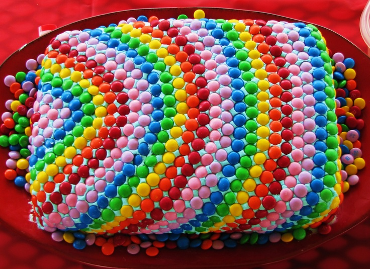 Rainbow cake for my daughter's rainbow party. LOTS of little chocolate candies :-)