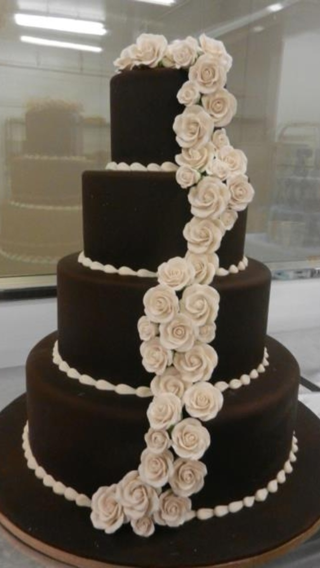 Carlos Bakery: Deep chocloate wedding cake with champagne colored roses: