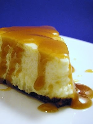 Eggnog Cheesecake with Caramel-Rum Sauce