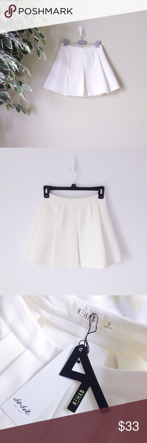 Rehab // White/Cream Pleated Skirt Pleated white/cream skirt! Made from a thicker material. Runs small. Will best fit those who are a size XS or XXS. Waist measures 11.5 in. Side zipper. 100% polyester. Slight discoloration on the side of skirt but very faint and hardly noticeable. Brand new.   Please ask all questions before purchase.  Colors may vary from one device/monitor to another as well as in person.  Discounted bundles || No trades/holds Rehab Skirts