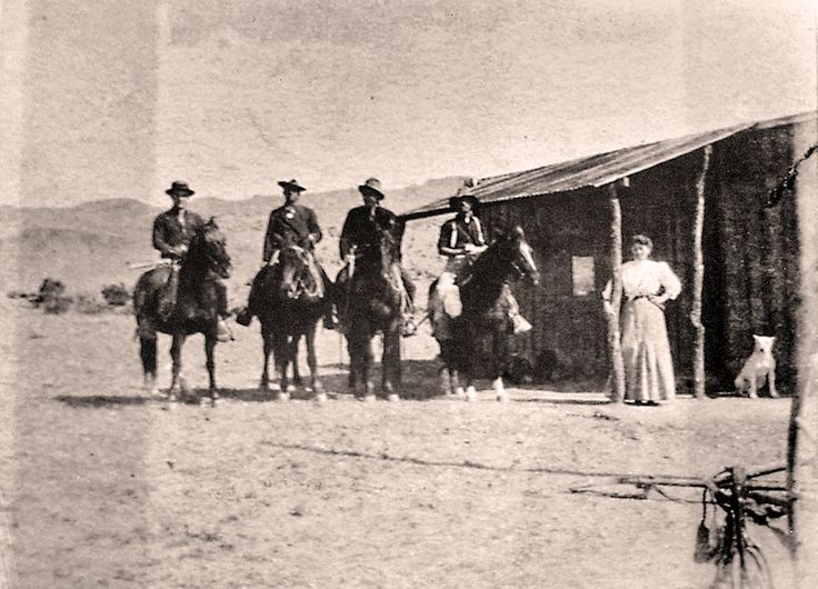 The Outlaw Cowboys of New Mexico - Susan McSween (connected to John Tunstall- Cattle Baron) Received a gift of Cattle from John Chisum. This house is in White Oaks... Note the architecture... Wood Siding in verticle form. Note the background mtns.