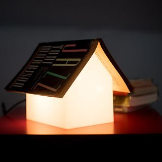 GIFT OF THE WEEK: Suck UK Bookrest Lamp $89.95 A soft, ambient light to read by that keeps your book place.  #Books #GiftsforBooklovers #BookGifts