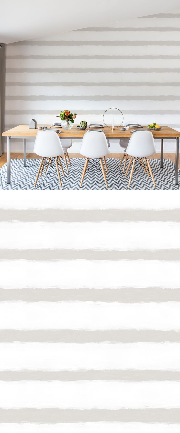 A light beige and white mural wallpaper with hand-painted stripes which reflects the seaside way of living.