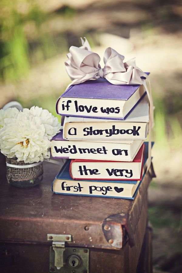 DIY Wedding Ideas for Brides Who Love Lettering | This decoration will look perfect next to your guest book. Find old vintage books at a thrift store and pen your favorite love quote on the side of the pages. Tie your finished project with a bow that matches your color scheme.