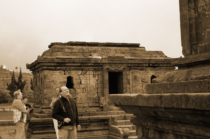 Captivated by the splendor, a foreign tourist stands still in front of the Arjuna Temple.