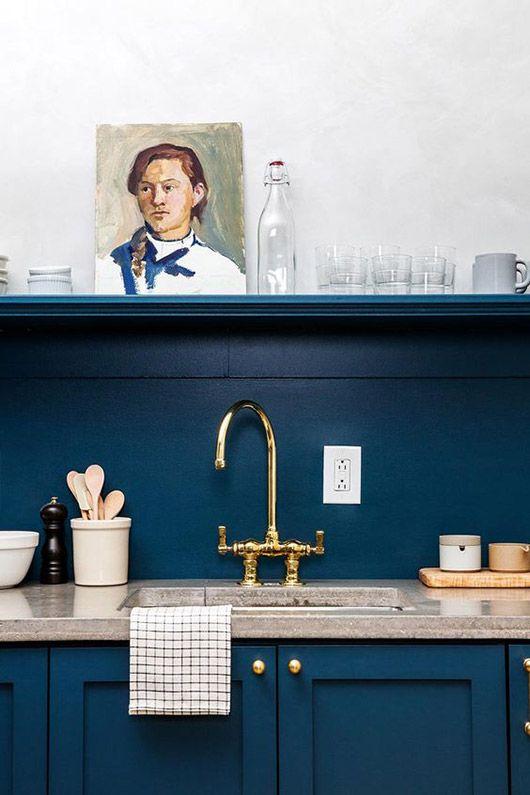blue kitchen cabinets and backsplash with vintage portrait. / sfgirlbybay