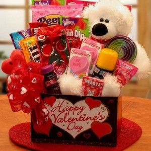Huggable Bear Kids Valentine Gift Box includes a unique Teddy Bear, color book, children's card games, candies and more for your younger Valentine sweethearts. Available from Arttowngifts.com.
