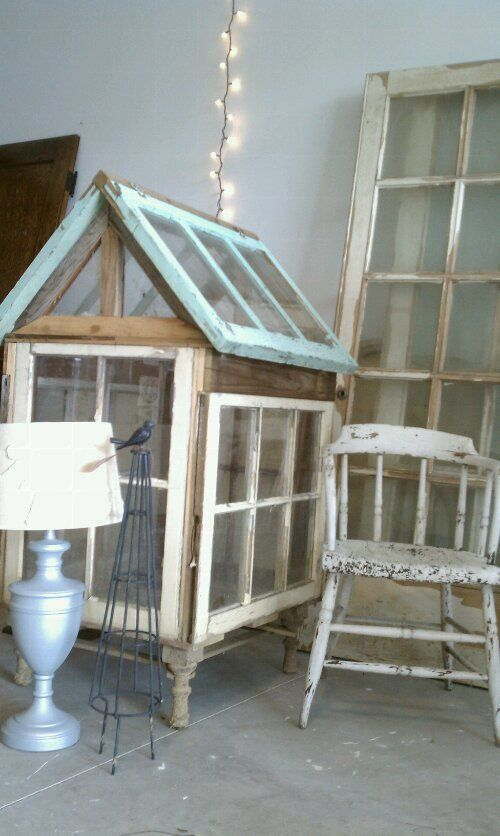 ❤️ Small greenhouse made with old windows. Love the cute legs on it!