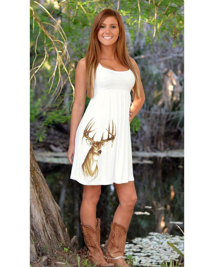 Check out this Cute off white Country style deer dress with a racerback and simple fit. The hottest dress of the season and a sure be a head turner. This dress is great to dress up or down. Model is 5'2 and wearing a small.