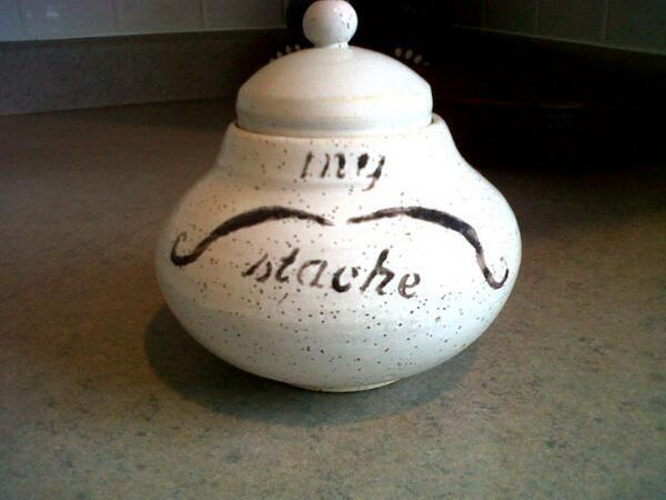 Corkey Movember mustache container.