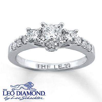 The centerpiece of this fiery diamond engagement ring for her is a stunning princess-cut Leo Diamond that has been independently certified and laser-inscribed with a unique Gemscribe® serial number. Additional princess-cut and round Leo Diamonds accent either side of the elegant engagement ring. The ring, styled in 14K white gold, has a total diamond weight of 7/8 carat.