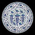 A large iznik pottery rimless grape dish, turkey, circa 1570