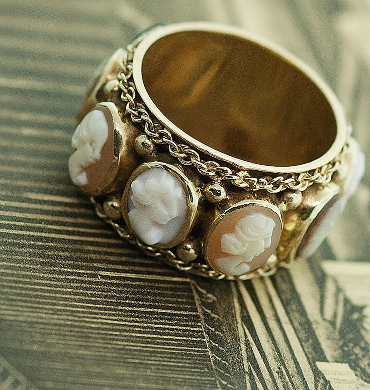 Vintage Cameo Band Ring. This reminds me if the cameos that dotted the royal jewels in the German castles I visited