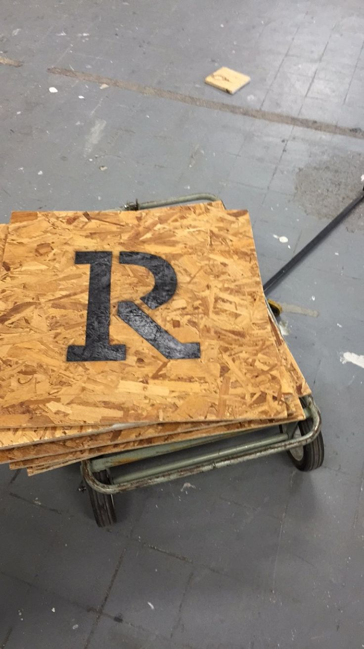 Letters getting sprayed onto the wood